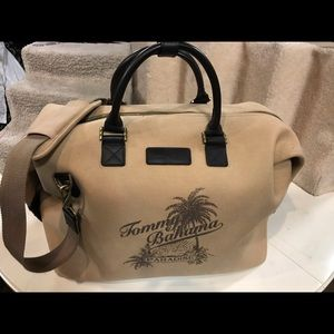 Tommy Bahamas tan with leather strap duffle bag